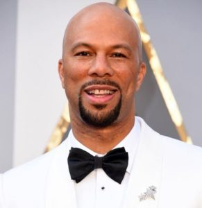 Common wearing Fred Leighton brooch and cufflinks and stud sets at the Oscars